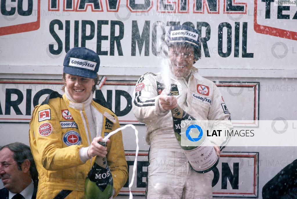 1978 Belgian Grand Prix.Zolder, Belgium. 21st May 1978.Mario Andretti and Ronnie Peterson on the podium.World Copyright: Murenbeeld/LAT Photographic