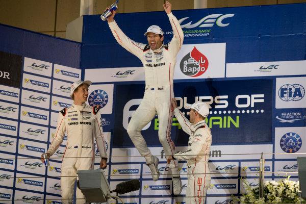 2015 WEC Bahrain International Circuit, Bahrain Saturday 21 November 2015. Mark Webber, Timo Bernhard and Brendon Hartley (#17 Porsche 919 Hybrid) celebrate on the podium after winning the drivers' championship. Photo: Sam Bloxham/LAT ref: Digital Image _SBL5899