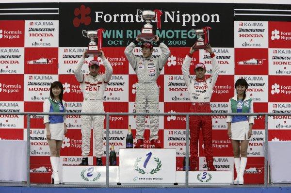 2005 Japanese Formula 3 ChampionshipMotegi, Japan. 23rd October 2005. Round 19Race podium - winner Hideki Mutoh (Honda M-Tec) 1st position, Joao Paulo de Oliveira (TOM's) 2nd position and Kazuki Nakajima (TOM's) 3rd.World Copyright: Yasushi Ishihara/LAT Photographicref: Digital Image 2005F3_R19_005