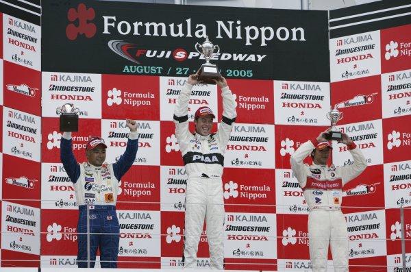 2005 Formula Nippon Championship.Round 7, Fuji Speedway, Japan. 28th August 2005Race Podium - winner Andre Lotterer (PIAA Nakajima) 1st, Tatsuya Kataoka (Forum Engineering) 2nd, and Yuji Ide (IMPUL) 3rd.World Copyright: Yasushi Ishihara / LAT Photographicref: Digital Image Only