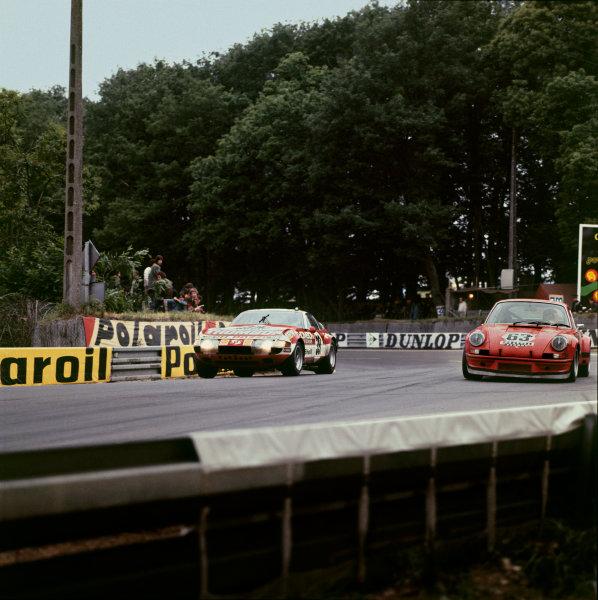 Le Mans, France. 9th - 10th June 1973.Claude Ballot-Lena/Vic Elford (Ferrari 365 GTB/4), 6th position, passes Georg Loos/Jurgen Barth (Porsche Carrera RSR), 10th position, action. World Copyright: LAT Photographic.Ref:  73LM