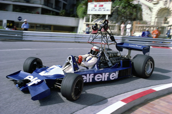 Jackie Stewart, Tyrrell 008 Ford, with movie cameras on board.