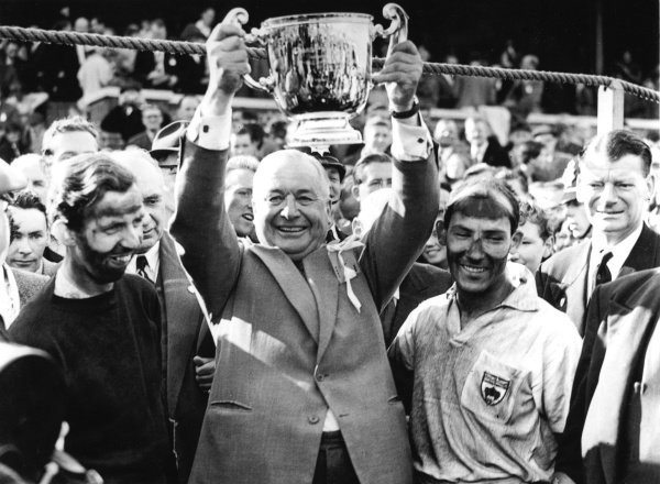 1957 British Grand Prix. Aintree, England. 18-20 July 1957. Tony Brooks, Tony Vandervell, Stirling Moss after winning for Vanwall. This was the first victory in a World Championship Grand Prix for a British car. World Copyright - LAT Photographic. Ref: Autocar Glass Plate C49678.