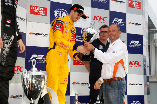 FIA F3 European Championship Hockenheim, Germany 1st - 3rd May 2015 3 Antonio Giovinazzi (ITA, Jagonya Ayam with Carlin, Dallara F312 - Volkswagen) getting the trophy of Christophe Stucki (Hankook Senior Manager Motorsport). (Race 3). Copyright Free FOR EDITORIAL USE ONLY. Mandatory Credit: FIA F3. ref: Digital Image FIAF3-1430677975