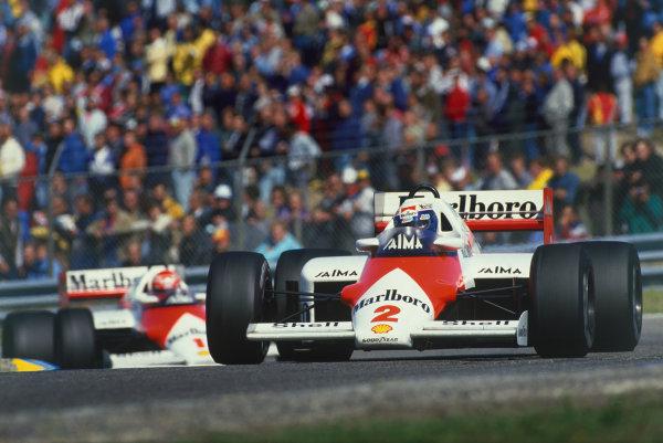 Zandvoort, Holland. 23-25 August 1985. Alain Prost leads Niki Lauda (both McLaren MP4/2B TAG Porsche). Ref: 85HOL39. World Copyright - LAT Photographic