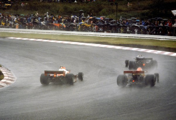 Niki Lauda (AUT) Ferrari 312T2 (Left) is passed in the appalling wet conditions by sixth placed Gunnar Nilsson (SWE) and ninth placed GP debutante Noritake Takahara (JPN) Surtees TS19, shortly before withdrawing from the race at the end of lap two because of the poor weather conditions.