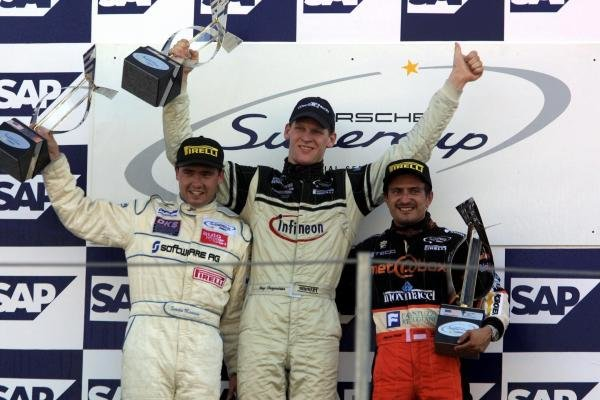 Podium and results:1st: Jorg Bergmeister (GER), centre2nd: Sascha Maassen (GER), left3rd: Stephane Ortelli (MON), rightPorsche Supercup, Indianapolis, USA, 30 September 2001