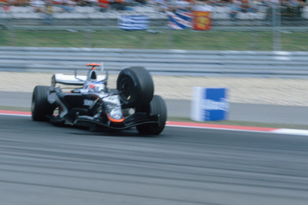 2005 European Grand Prix - Sunday Race Nurburgring, Germany 29th May 2005Kimi Raikkonen, McLaren Mercedes MP4-20, crashes into the tyre wall after his front right tyre tore away from the car, shattering the wishbone World Copyright: Steven Tee/LAT Photographic ref: 35mm 50mb Scan 05EuropeC00