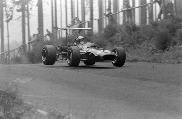 Piers Courage, BRM P126, gets airborne.