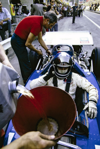 Jean-Pierre Beltoise, Matra MS120 gets refuelled in the pit lane.