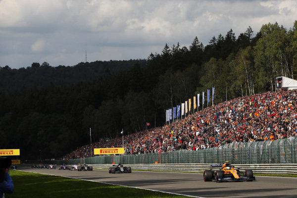 Lando Norris, McLaren MCL34, leads Kevin Magnussen, Haas VF-19 and Romain Grosjean, Haas VF-19