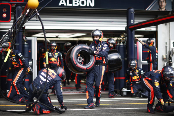 The Red Bull pit crew take up their positions