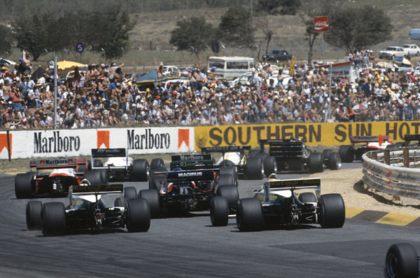A rear view of the start at Turn 1. Derek Warwick, Toleman TG183B Hart races ahead of the Arrows A6 Fords of Marc Surer and Thierry Boutsen.