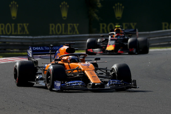 Carlos Sainz Jr., McLaren MCL34, leads Pierre Gasly, Red Bull Racing RB15
