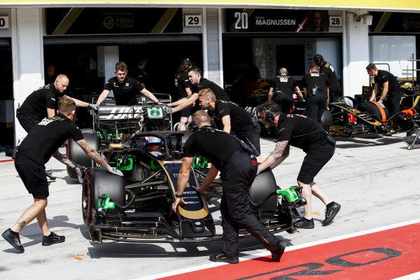 Romain Grosjean, Haas VF-19, is returned to the garage