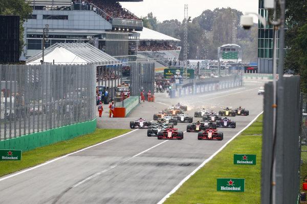Start of the race with Kimi Raikkonen, Ferrari SF71H, leading Sebastian Vettel, Ferrari SF71H and Lewis Hamilton, Mercedes AMG F1 W09.
