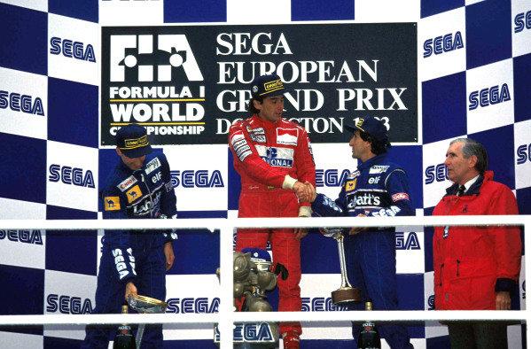 Damon Hill, 2nd position, Ayrton Senna, 1st position, and Alain Prost, 3rd position, on the podium.