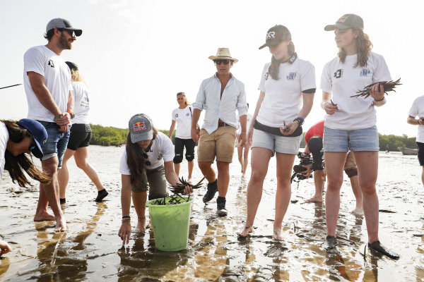 Formula E driver Jean Eric Vergne, Molly Taylor (AUS), Rosberg X Racing, and Catie Munnings (GBR), Andretti United Extreme E, on the Oceanium Mangrove Legacy Project Visit