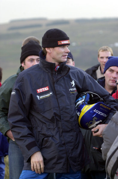 2002 World Rally Championship.Network Q Rally of Great Britain, Cardiff. November 14-17. Marcus Gronholm chats with fans after rolling out on Stage 10, Halfway 1.Photo: Ralph Hardwick/LAT