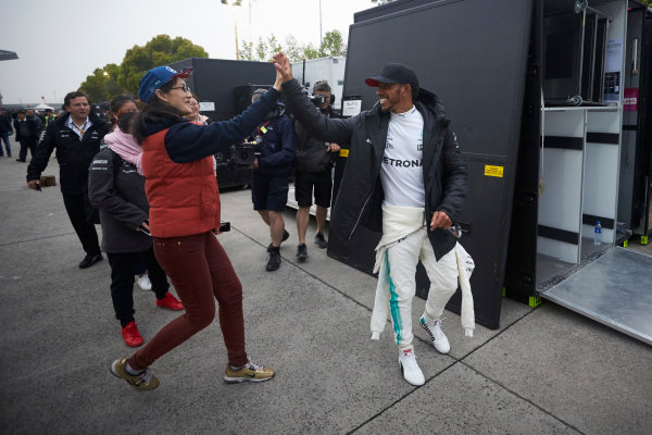 Shanghai International Circuit, Shanghai, China.  Sunday 9 April 2017. Lewis Hamilton, Mercedes AMG, high fives a fan. World Copyright: Steve Etherington/LAT Images ref: Digital Image SNE19152
