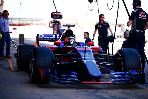 Circuit de Barcelona Catalunya, Barcelona, Spain. Friday 10 March 2017. Carlos Sainz Jr, Toro Rosso STR12 Renault, exits his pit. The Spaniard's father Carlos Sr looks on. World Copyright: Sam Bloxham/LAT Images ref: Digital Image _SLB0831