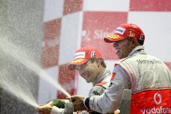Marina Bay Circuit, Singapore. 27th September 2009. Lewis Hamilton, McLaren MP4-24 Mercedes, 1st position, and Timo Glock, Toyota TF109, 2nd position, spray the champagne. Portrait. Podium.  World Copyright: Glenn Dunbar/LAT Photographic  ref: Digital Image _3GD6867