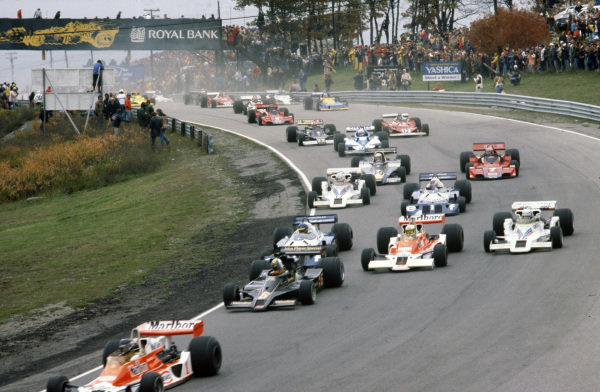 James Hunt, McLaren M26 Ford leads Gunnar Nilsson, Lotus 78 Ford, Jochen Mass, McLaren M26 Ford, Ronnie Peterson, Tyrrell P34 Ford and Riccardo Patrese, Shadow DN8 Ford.