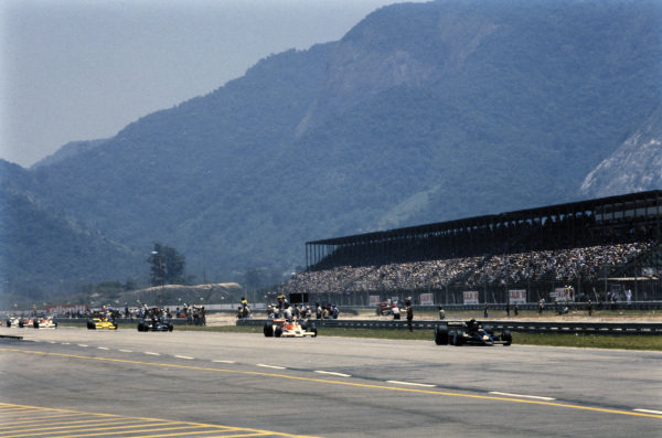 Ronnie Peterson, Lotus 78 Ford, leads James Hunt, McLaren M26 Ford and team mate Mario Andretti, Lotus 78 Ford.