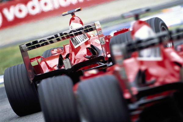 Michael Schumacher, Ferrari F2004 leads Rubens Barrichello, Ferrari F2004.