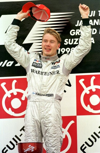 Japanese Grand Prix.Suzuka, Japan.30/10-1/11 1998.Mika Hakkinen (McLaren Mercedes-Benz) celebrates finishing in 1st position clinching the World Championship.World Copyright - Steve Etherington/LAT Photographic