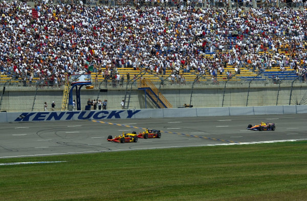 Polesitter Scott Sharp (8) leads teamate Mark Dismore and Robbie Buhl to the green flag.