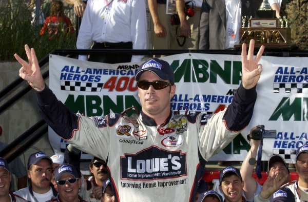 2002 NASCAR,Dover Downs,Sept 20-22, 20022002 NASCAR, Dover,Del . USA -Jimmie Johnson out of car with 3 fingers for 3 wins in 2002,Copyright-Robt LeSieur2002LAT Photographic