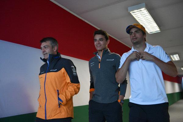 Paul James, Team Manager, McLaren, Lando Norris, McLaren, and Carlos Sainz Jr, McLaren