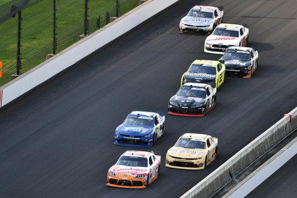#18: Kyle Busch, Joe Gibbs Racing, Toyota Supra Combos and #11: Justin Haley, Kaulig Racing, Chevrolet Camaro LeafFilter