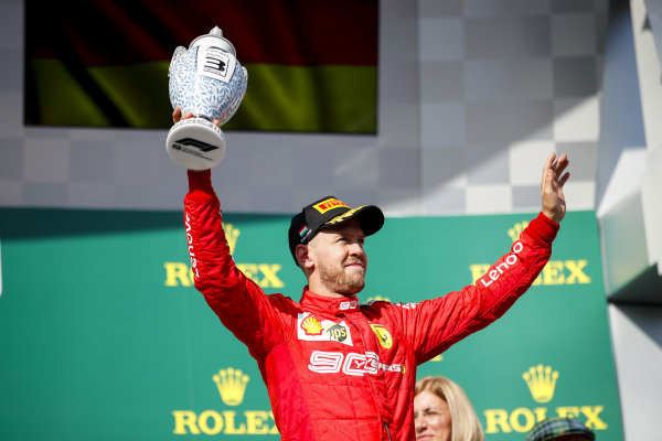 Sebastian Vettel, Ferrari, 3rd position, celebrates with his trophy