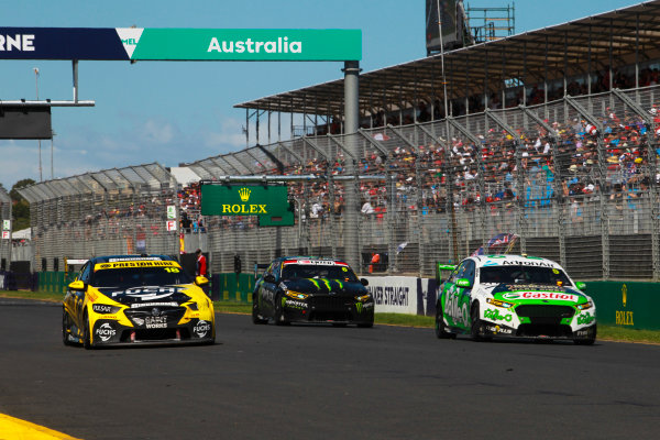 Mark Winterbottom, Tickford Racing Ford, leads Lee Holdsworth, Charlie Schwerkolt Racing Holden, and Cameron Waters, Tickford Racing Ford.