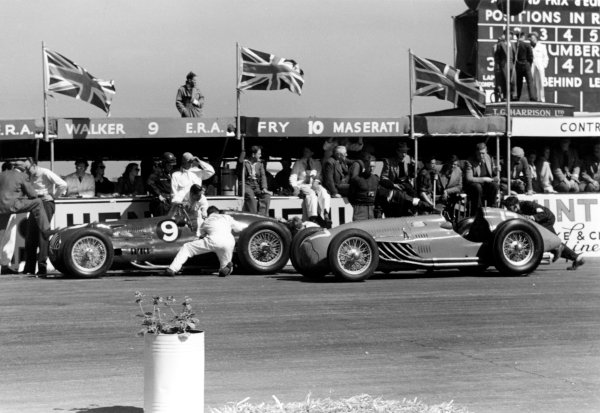 1950 British Grand Prix.Silverstone, Great Britain. 13th May 1950.Peter Walker/Tony Rolt (ERA E-type, number 9) and Eugene Martin (Lago-Talbot T26C-DA) in the pits.World Copyright: LAT Photographicref: 3734I/20