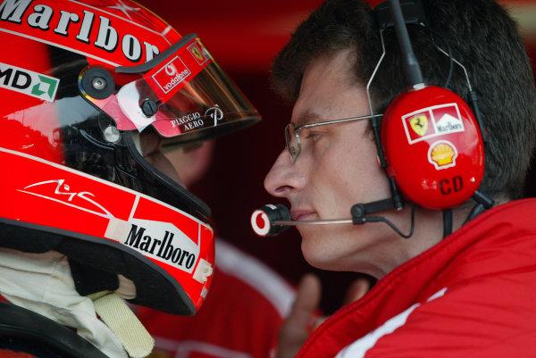 2004 Monaco Grand Prix - Thursday Practice,Monaco. 20th May 2004 Michael Schumacher, Ferrari F2004, with race engineer Chris Dyer. Portrait.World Copyright: Steve Etherington/LAT Photographic ref: Digital Image Only