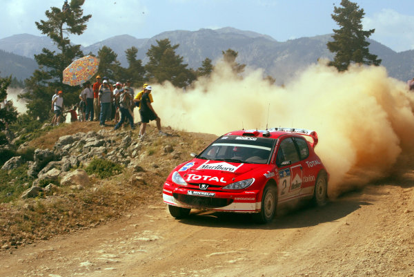 Richard Burns in action in the Peugeot 206 WRC, Acropolis Rally 2003. Photo: McKlein/LAT