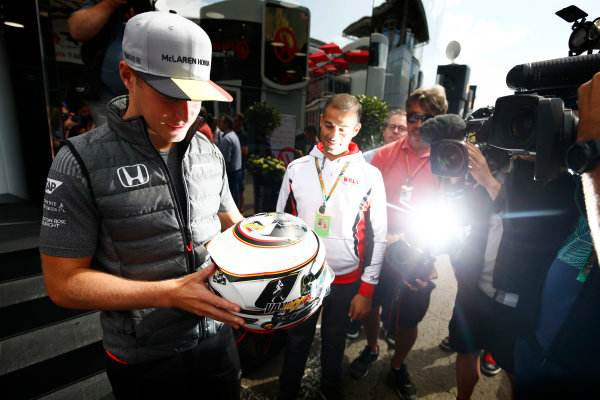 Spa Francorchamps, Belgium.  Thursday 24 August 2017. Stoffel Vandoorne, McLaren, examines a helmet in front of media. World Copyright: Andy Hone/LAT Images  ref: Digital Image _ONZ8215