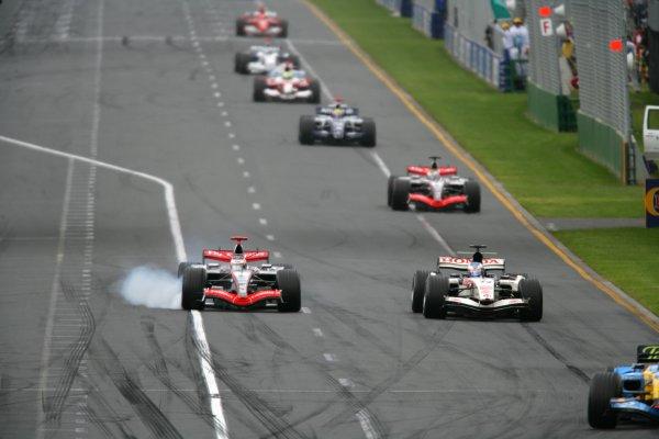 2006 Australian Grand Prix - Sunday Race Albert Park, Melbourne, Australia. 29th March - 2nd April 2006 Fernando Alonso, Renault R26, 1st position, leads as and Kimi Raikkonen, McLaren MP4/21-Mercedes-Benz, 2nd position, attempts to pass Jenson Button, Honda RA106, 9th position, early in the race. Juan Pablo Montoya, McLaren MP4/21-Mercedes-Benz, retired, Mark Webber, Williams FW28-Cosworth, retired, Ralf Schumacher, Toyota TF106, 3rd position, Nick Heidfeld, Sauber F1.06-BMW, 4th position, and Michael Schumacher, Ferrari 248F1, retired, follow, action. World Copyright: Glenn Dunbar/LAT Photographic ref: Digital Image YY8P7380.