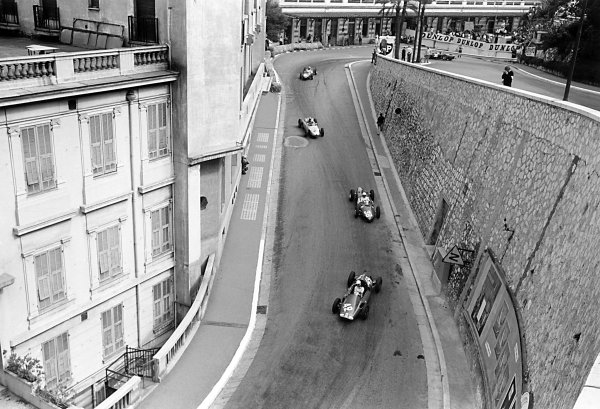 1961 Monaco Grand Prix Monte Carlo, Monaco. 11-14 May 1961 Maurice Trintignant (Cooper T51-Maserati) leads Phil Hill (Ferrari 156), Jo Bonnier (Porsche 787), Wolfgang von Trips and Richie Ginther (both Ferrari 156) out of the Old Station Hairpin World Copyright: LAT PhotographicRef: Autosport b&w print