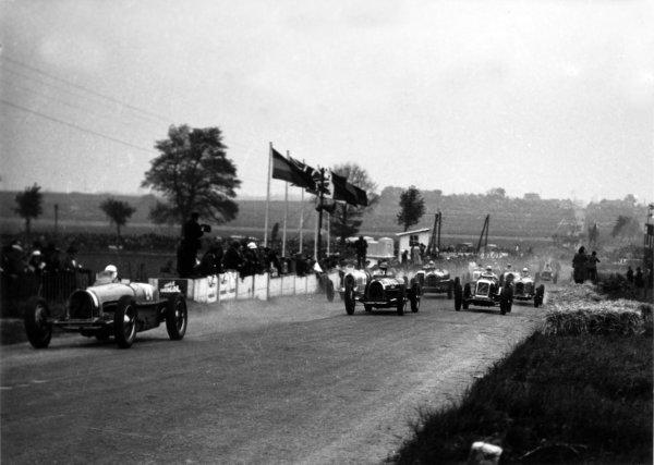 "1935 Picardie Grand Prix Peronne, France. 26 May 1935 Robert Benoist, #24 Bugatti T59, leads Earl Howe, #22 Bugatti T59, Robert Brunet, #4 Maserati 8CM, Raymond Sommer, #2 Alfa Romeo Tipo-B ""P3"", ""Mlle Helle-Nice"", #14 Alfa Romeo 8C ""Monza"", and Jean Delorme, #12 Bugatti T51, at the start, action World Copyright: Robert Fellowes/LAT PhotographicRef: 35PIC07"