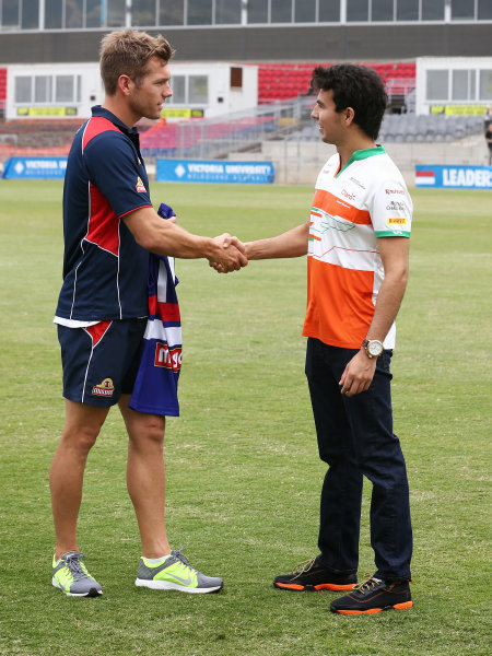Nico Hulkenberg (GER) Force India F1 and Sergio Perez (MEX) Force India F1 with AFL Premiership Western Bulldogs at Whitten Oval.