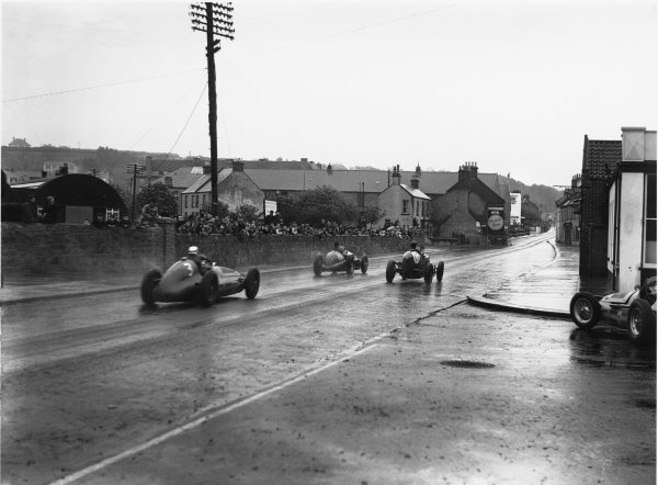 St Helier, Jersey, Channel Islands. 28th April 1949.Peter Whitehead (Ferrari 125/10C) and Geoffrey Ansell (ERA R98) lead Gigi Villoresi (Maserati 4CLT), action.World Copyright: LAT Photographic.Ref: Autocar Glass Plate C24068.