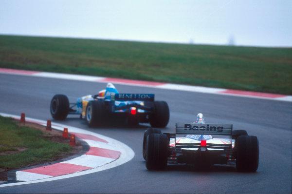 Nurburgring, Germany.29/9-1/10 1995.Michael Schumacher (Benetton B195 Renault) leads Damon Hill (Williams FW17B Renault).Ref-95 EUR 05.World Copyright - LAT Photographic