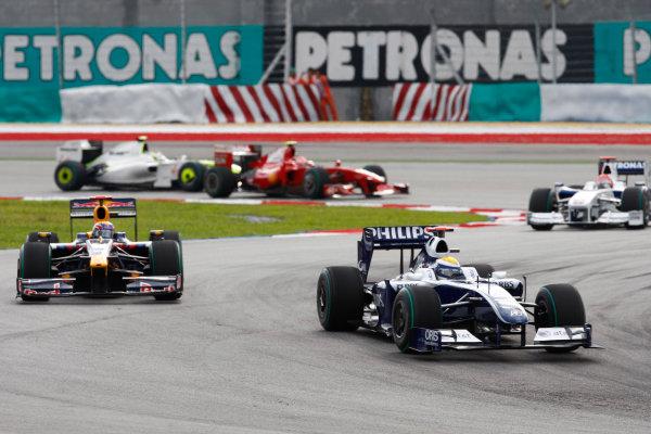 Sepang, Kuala Lumpur, Malaysia5th April 2009Nico Rosberg, Williams FW31 Toyota, 8th position, leads Mark Webber, Red Bull Racing RB5 Renault, 6th position, Robert Kubica, BMW Sauber F1 09, retired,  Kimi Raikkonen, Ferrari F60, 14th position, and Rubens Barrichello, Brawn GP BGP001 Mercedes, 5th position. Action. World Copyright: Steven Tee/LAT Photographicref: Digital Image _95U9732