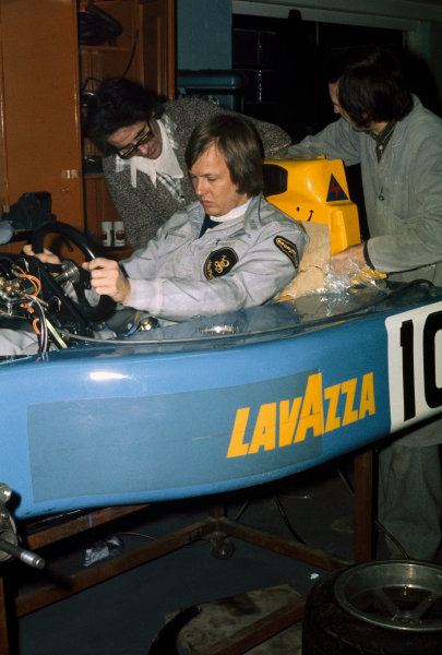 Bicester, England.Ronnie Peterson has a seat fitting at March Engineering in the March 761, portrait. World Copyright: LAT Photographic.Ref: Colour Transparency.