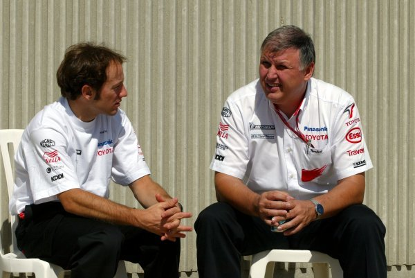 (L to R): Cristiano Da Matta (BRA) Toyota and Norbert Kreyer (GER) Senior General Manager of Race and Test Engineering.Formula One World Championship, Rd15, United States Grand Prix, Preparations, Indianapolis, USA, 25 September 2003.DIGITAL IMAGE