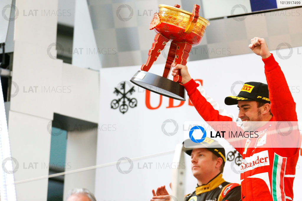 Shanghai International Circuit, Shanghai, China Sunday 14th April 2013 Fernando Alonso, Ferrari, 1st position, celebrates with his trophy on the podium. World Copyright: Alastair Staley/LAT Photographic ref: Digital Image _R6T2440